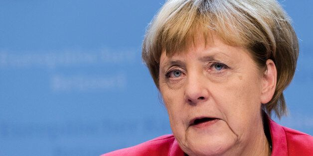 German Chancellor Angela Merkel addresses the media after the first day of an EU summit in Brussels early...