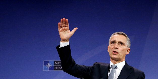 NATO Secretary-General Jens Stoltenberg addresses a news conference during a NATO defence ministers meeting...
