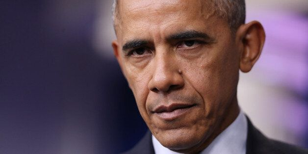 President Barack Obama listens to questions during a news conference in the Brady press briefing room...