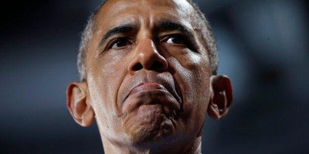 President Barack Obama pauses while speaking at University of New Hampshire, Monday, Nov. 7, 2016 in...