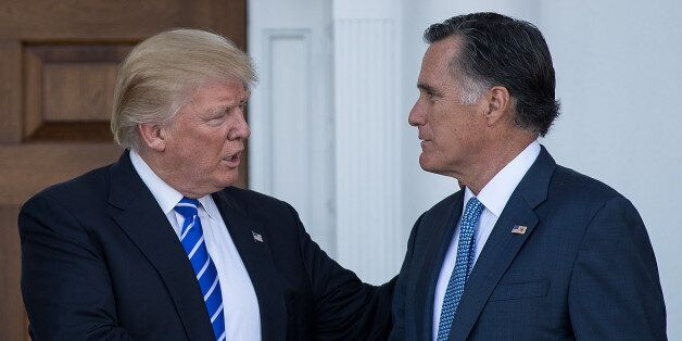 BEDMINSTER TOWNSHIP, NJ - NOVEMBER 19: (L to R) President-elect Donald Trump shakes hands with Mitt Romney...