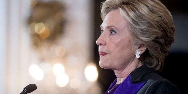 Hillary Clinton pauses while speaking in New York, Wednesday, Nov. 9, 2016, where she conceded her defeat...
