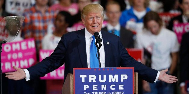 Republican presidential candidate, Donald Trump, speaks during a campaign rally late Saturday, Nov. 5,...