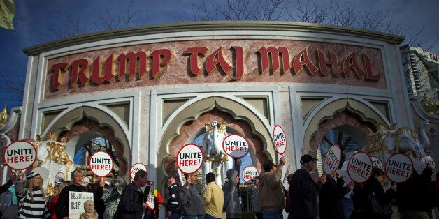 FILE PHOTO: Union members from UNITE HERE Local 54 rally outside the Trump Taj Mahal Casino in Atlantic...