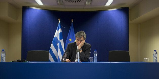 Euclid Tsakalotos, Greece's finance minister, looks on following a news conference after a Eurogroup...