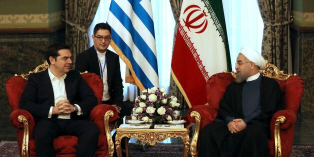 Iranian President Hassan Rouhani, right, meets with Greek Prime Minister Alexis Tsipras in Tehran, Iran,...