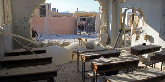 TOPSHOT - A general view shows a damaged classroom at a school after it was hit in an air strike in the...
