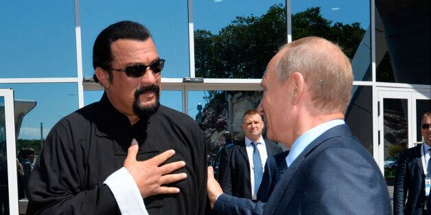 FILE - In this Sept. 4, 2015, file photo, Russian President Vladimir Putin, right, speaks with U.S. actor...