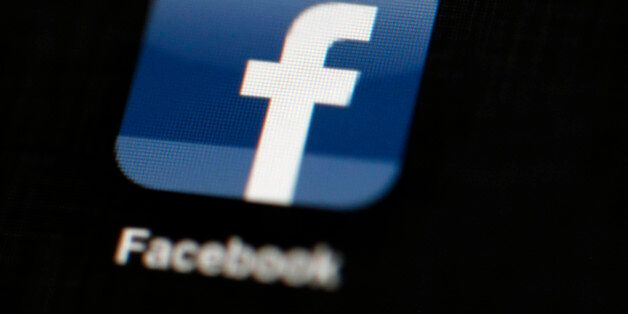 FILE - In this May 16, 2012, file photo, the Facebook logo is displayed on an iPad in Philadelphia. Facebook...