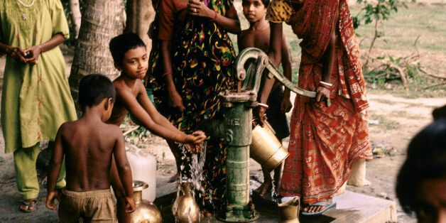 In the 1970's UNICEF initiated the boring of deep wells in villages across the Ganges Delta in a well...