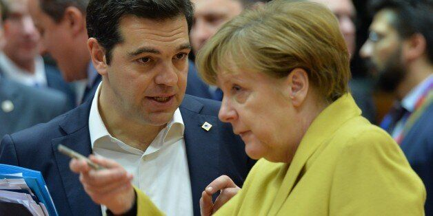 BRUSSELS, BELGIUM - MARCH 18: Greek Prime Minister Alexis Tsipras (L) and German Chancellor Angela Merkel...