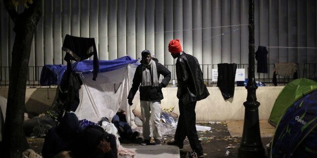 Migrants gather in a makeshift camp in Paris, Friday, Nov. 4, 2016. Police and city officials are clearing...