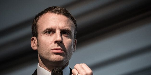 Former French Economy Minister Emmanuel Macron speaks during a press conference to unveil the organisation's...