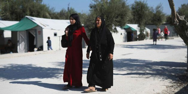 Two Syrian women walk at the Kara Tepe camp for refugees and other migrants on Lesbos island, Greece,...
