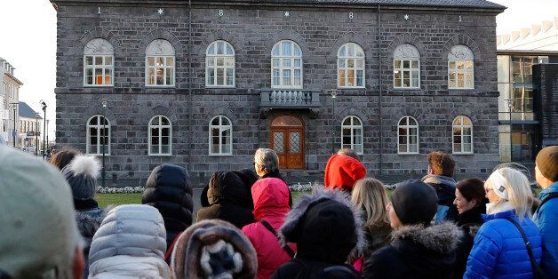 People look at the Althing parliament in Reykjavik, Thursday, Oct. 27, 2016. Parliamentary elections...
