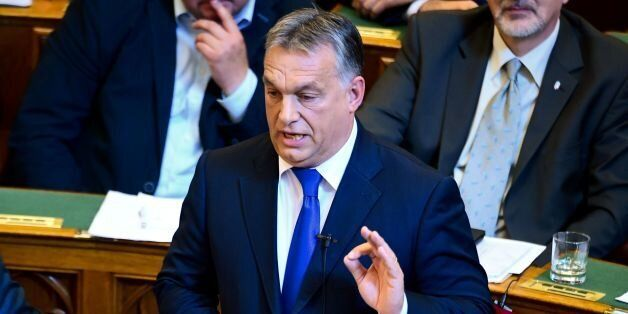 Hungarian Prime Minister Viktor Orban gives a speech at the parliament in Budapest on October 3, 2016.Orban...
