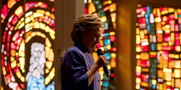 Democratic presidential candidate Hillary Clinton pauses while speaking at New Mount Olive Baptist Church...