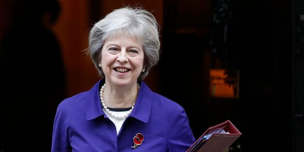 Britain's Prime Minister Theresa May leaves Downing Street to attend the weekly Prime Ministers' Questions...