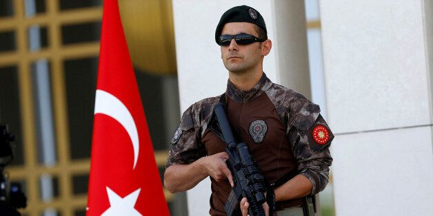 FILE PHOTO - A Turkish special forces police officer guards the entrance of the Presidential Palace in...
