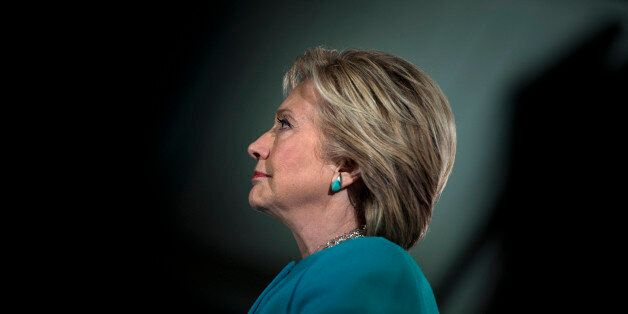 TOPSHOT - US Democratic presidential nominee Hillary Clinton waits to speak during a rally at the Armory...