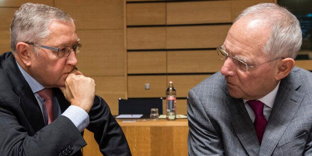 Germany's Finance Minister Wolfgang Schauble, right, talks with European Stability Mechanism Managing...