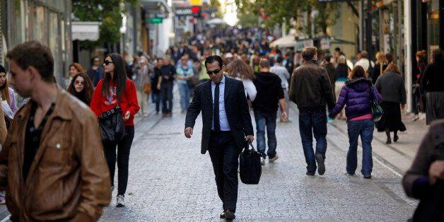 Pedestrians walk along a street in the Ermou shopping district of Athens, Greece, on Tuesday, Nov. 1,...