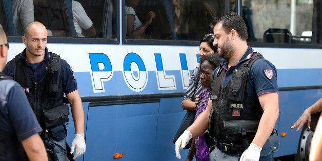 ROME, ITALY - AUGUST 11: Migrants are taken in bus to a police station for identification during police...