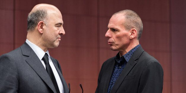 European Commissioner for Economic and Financial Affairs Pierre Moscovici, left, talks with Greek Finance...