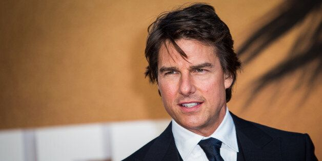 Actor Tom Cruise poses for photographers upon arrival at the premiere of the film 'Jack Reacher: Never Go Back' in London, Thursday, Oct. 20, 2016. (Photo by Vianney Le Caer/Invision/AP)