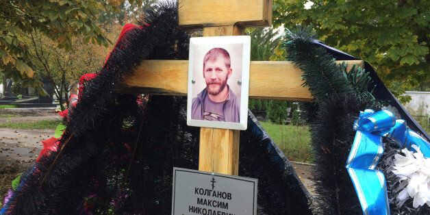 A portrait of Russian contractor Maxim Kolganov, who was killed in combat in Syria, is pictured on a...