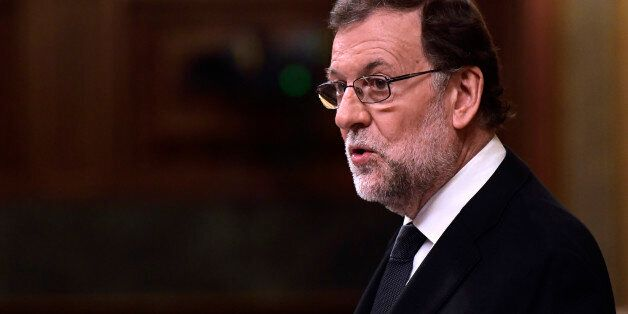 Spanish interim Prime Minister Mariano Rajoy speaks during the parliamentary investiture vote for a prime...