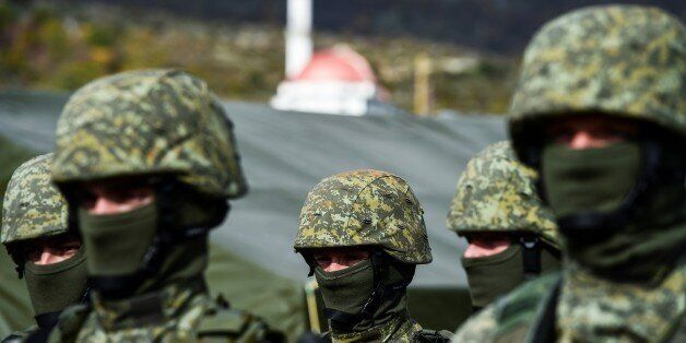 Members of the Kosovo Security Force take part in a field exercise in the village of Nashec near the...