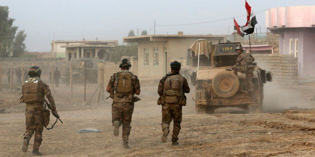 Iraq's elite counterterrorism forces advance toward Islamic State positions in the village of Tob Zawa,...