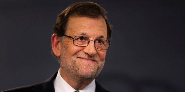 Spain's acting conservative Prime Minister, Mariano Rajoy, listens to a question during a news conference...