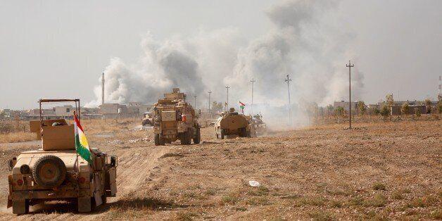 MOSUL, IRAQ - NOVEMBER 7: Iraqi Kurdish Regional Government's peshmerga forces attack Daesh terrorists...