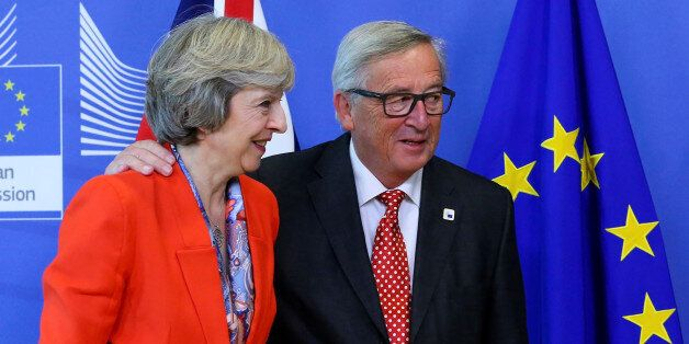 British Prime Minister Theresa May (L) is welcomed by European Commission President Jean-Claude Juncker...