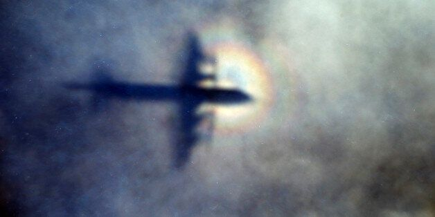 FILE - In this March 31, 2014 file photo, the shadow of a Royal New Zealand Air Force P3 Orion is seen...