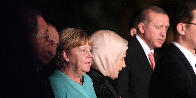 German Chancellor Angela Merkel (3rd L), Russia's President Vladimir Putin (2nd L), and Turkey's President...