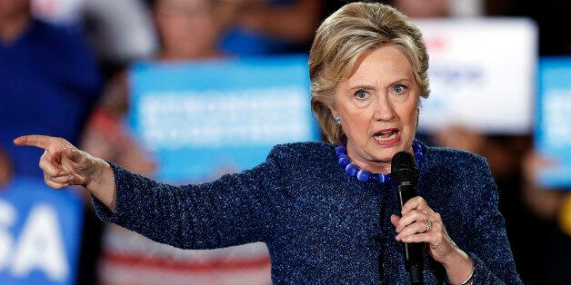 Democratic presidential candidate Hillary Clinton speaks during a rally at Theodore Roosevelt High School...