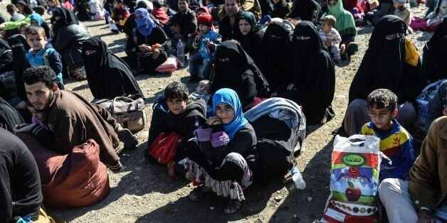 Iraqi families, who fled the violence due to the ongoing operation by Iraqi forces against jihadists...