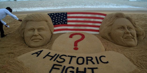 Visitors look near to the sand sculpture creating by sand artist Sudarsan Pattnaik of USA presidential...