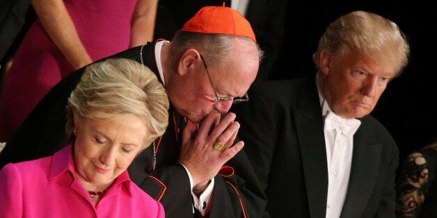 (L-R) Democratic U.S. presidential nominee Hillary Clinton, Archbishop of New York Cardinal Timothy Dolan...