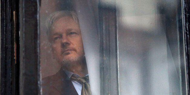 WikiLeaks founder Julian Assange walks onto the balcony of the Ecuadorean Embassy to addresses waiting...