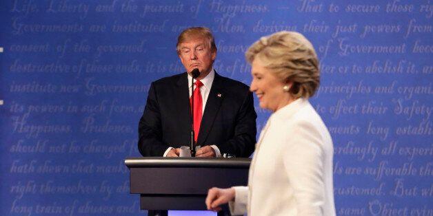 Republican presidential nominee Donald Trump waits behind his podium as Democratic presidential nominee...