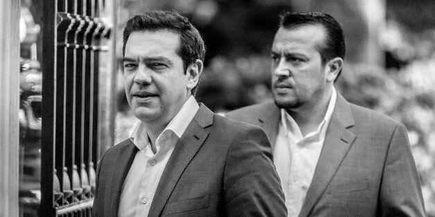 Alexis Tsipras, Greece's Prime Minister, left, and Nikos Pappas, Greece's Minister of State, right, outside...