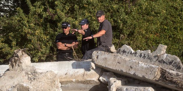 KOS, GREECE - OCTOBER 08: South Yorkshire Police officers look over the new second search site approximately...