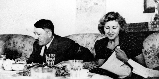 Our undated picture shows the German Fuehrer Adolf Hitler and his mistress Eva Braun while dining. (AP-Photo/Eva...