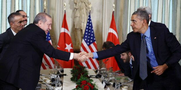 U.S. President Barack Obama, right, shakes hands with Turkish President Recep Tayyip Erdogan after a...
