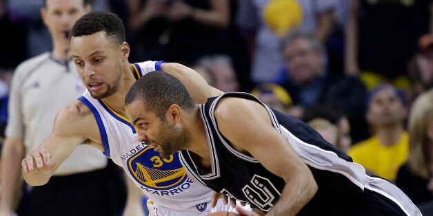 San Antonio Spurs' Tony Parker, right, tries to dribble around Golden State Warriors' Stephen Curry during...
