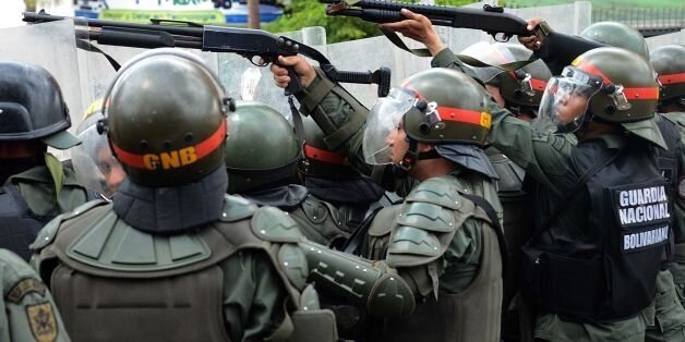 National Guard members shoot tear gas at opposition activists during a protest in San Cristobal, state...